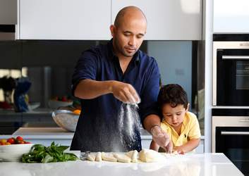 Adam D'Sylva makes gnocchi with his son, Javier.
