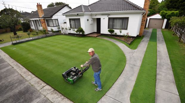 Chris Sadowski mowing his immaculate front lawn in Oakleigh South