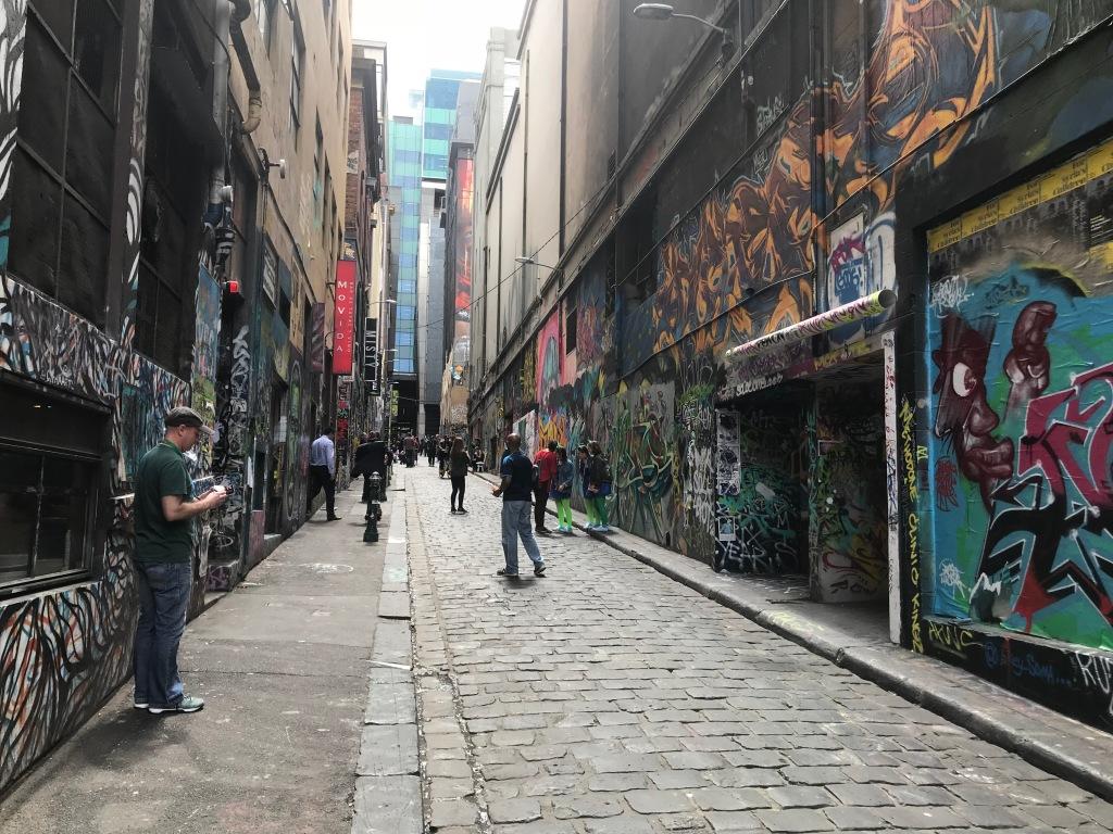 People looking at street art in Hosier Lane, Melbourne.