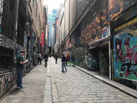 People looking at street art in Hosier Lane, Melbourne.